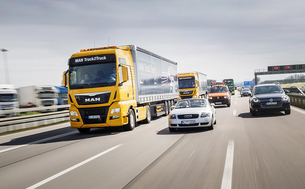 truck insurance –two MAN Automotive trucks driving on a busy road. MAN Financial Services South Africa offer comprehensive solutions for bus- and truck insurance.
